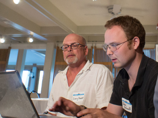 Larry and Jason working on the database.